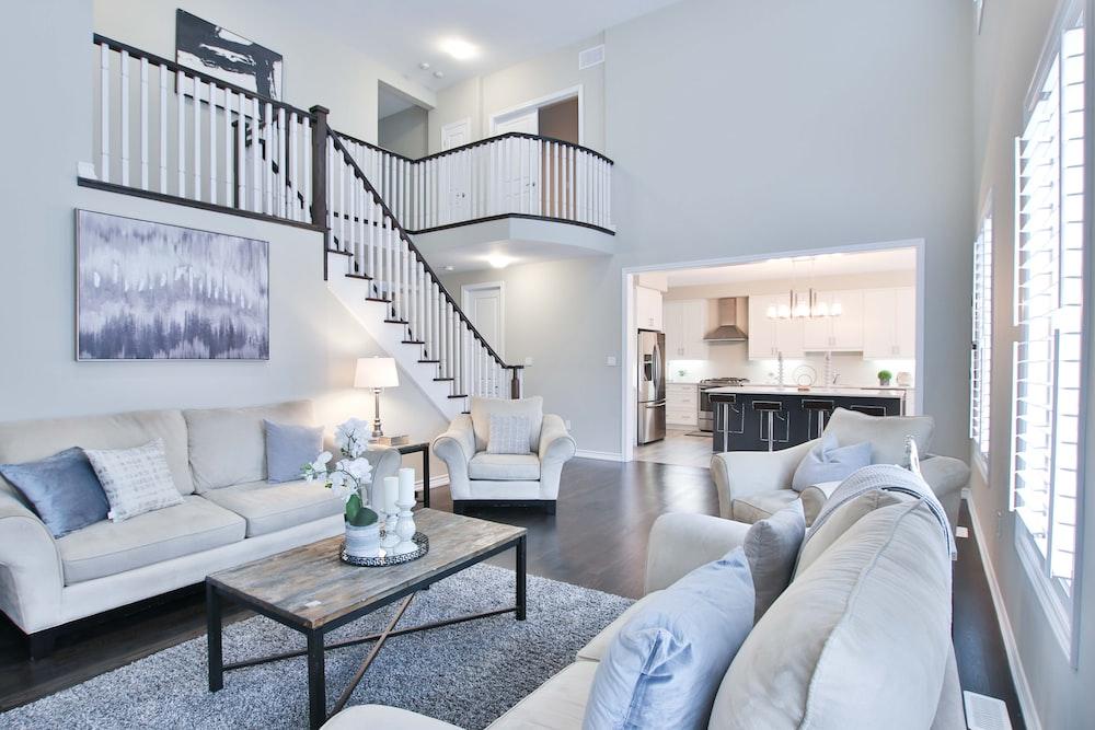 white fabric sofa set