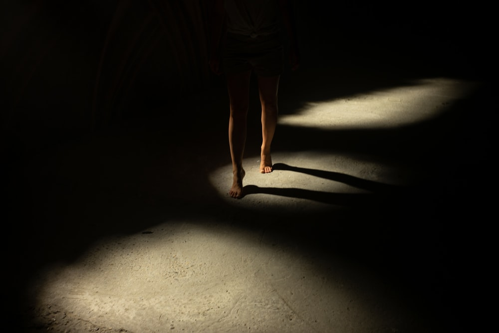 person walking on dimmed lighted room