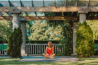 woman siting on focus photography zen garden zoom background