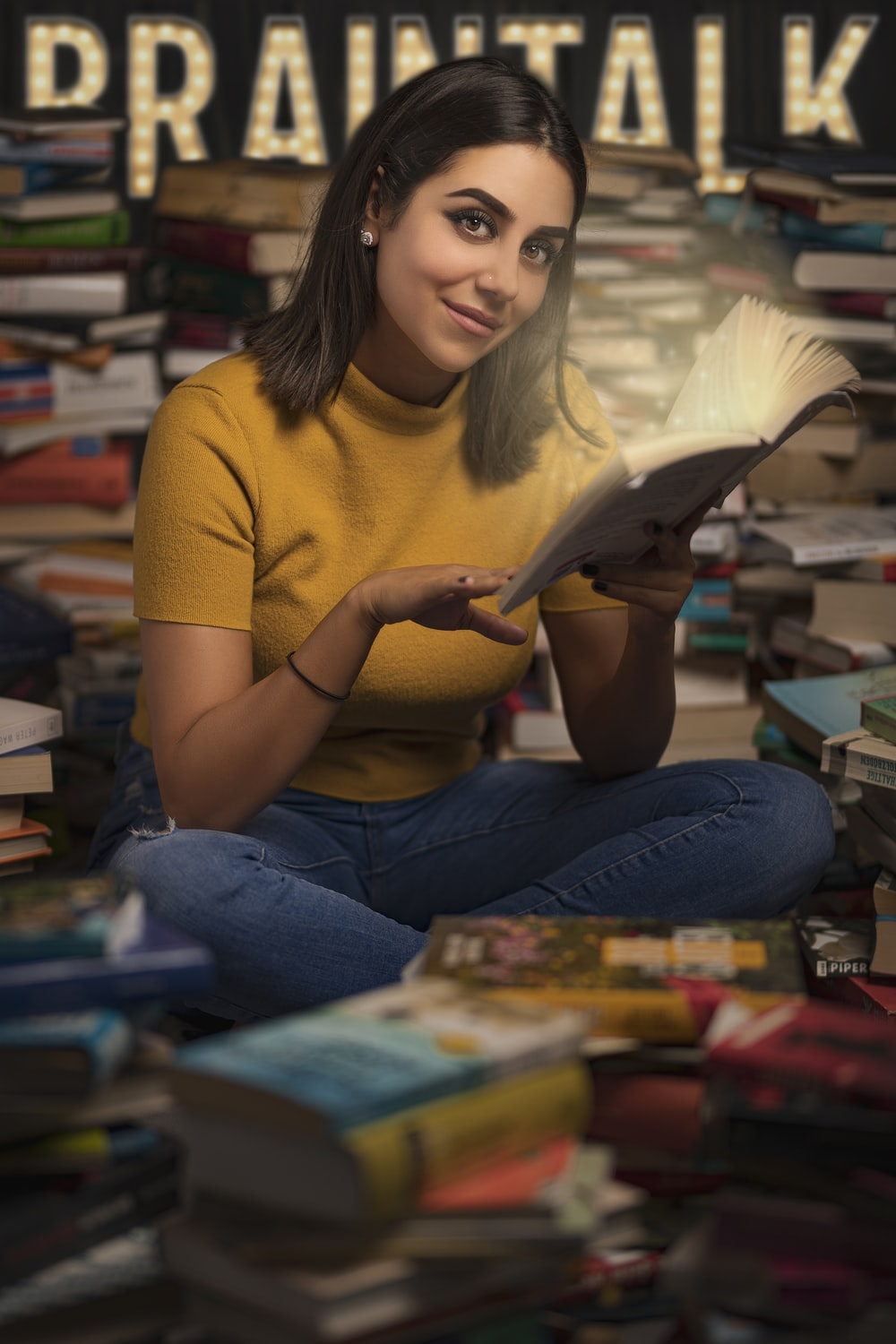 woman in yellow t-shirt reading book
