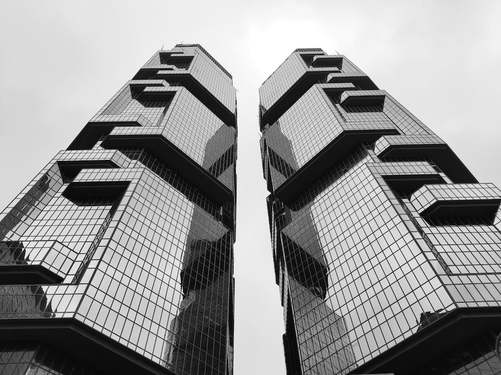grayscale photography of glass walled high-rise building