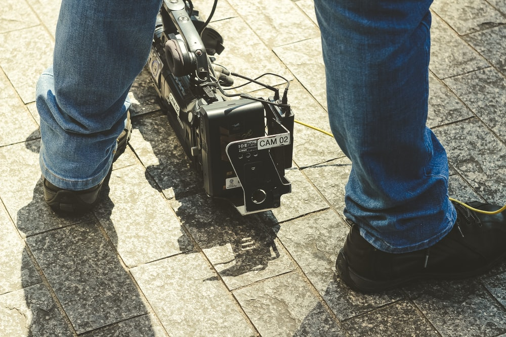 black camera stabilizer on ground