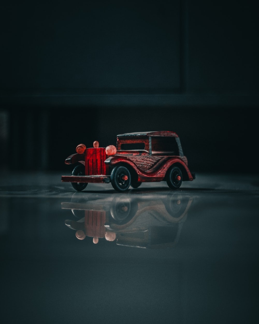 red and black vehicle scale model