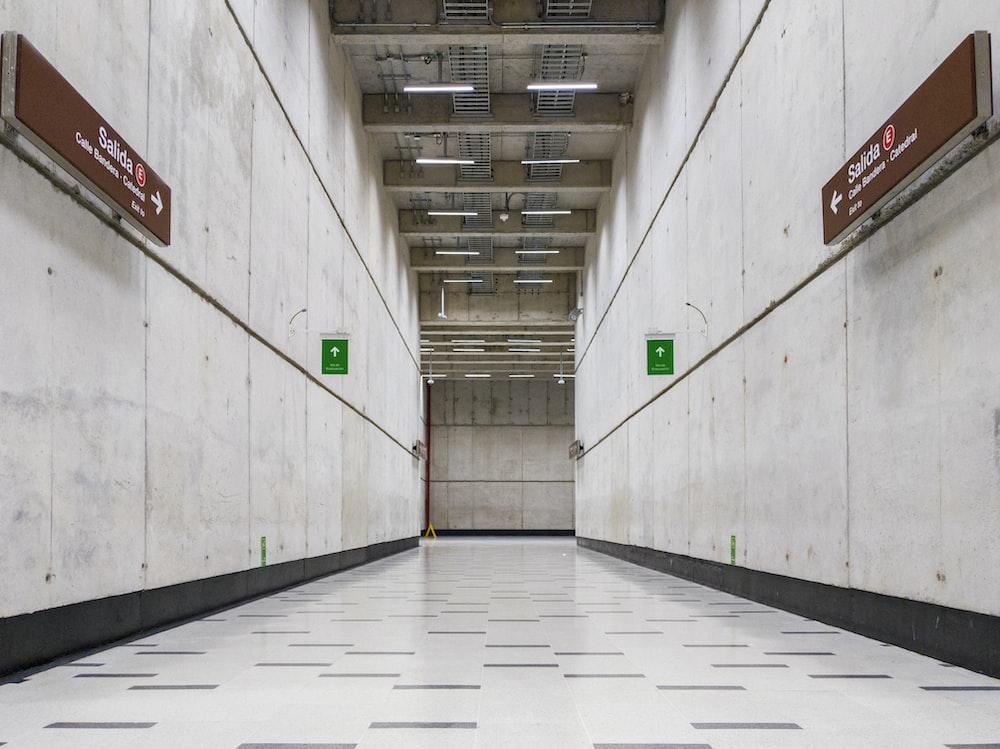 white concrete floor beside wall