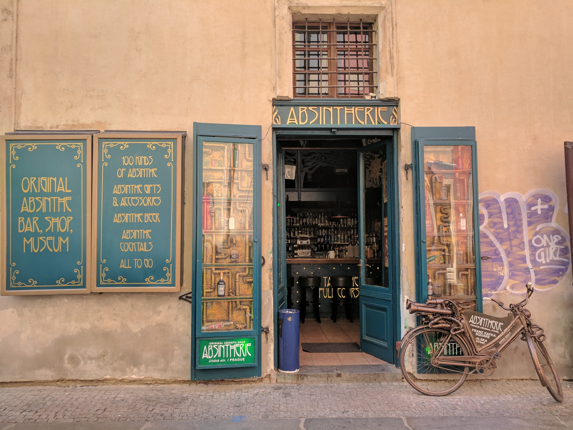Absintherie shopfront with steampunk bicycle