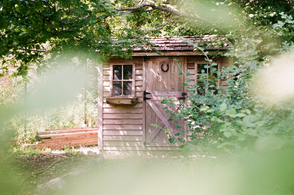 focus photography of brown wooden shed