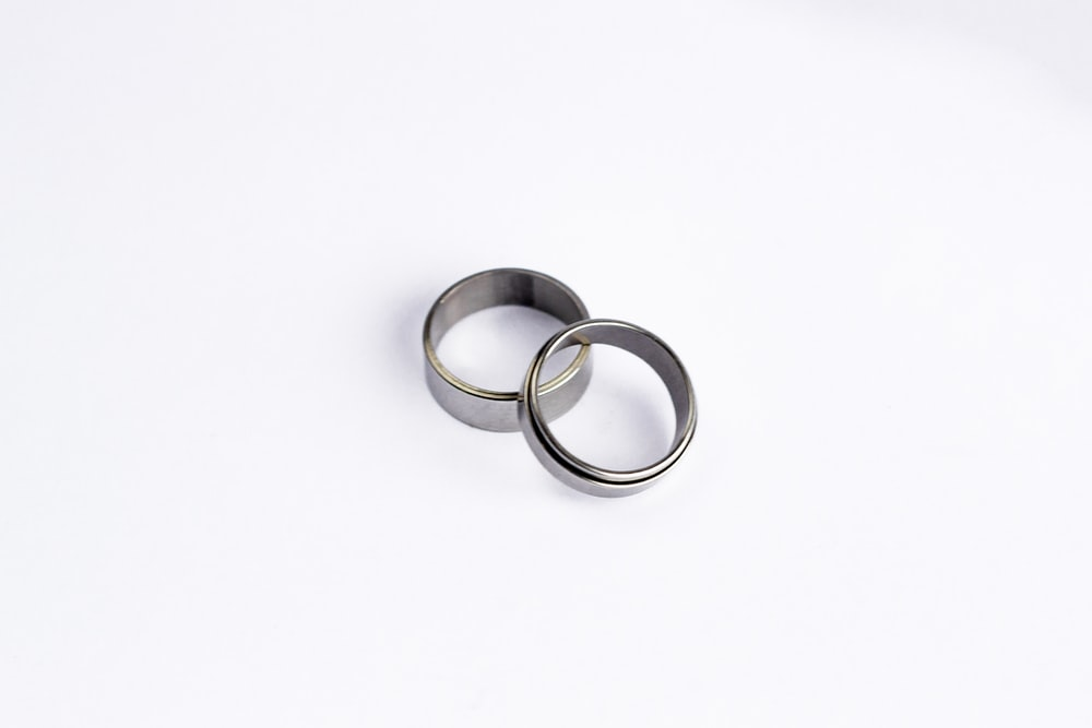 two silver ring band