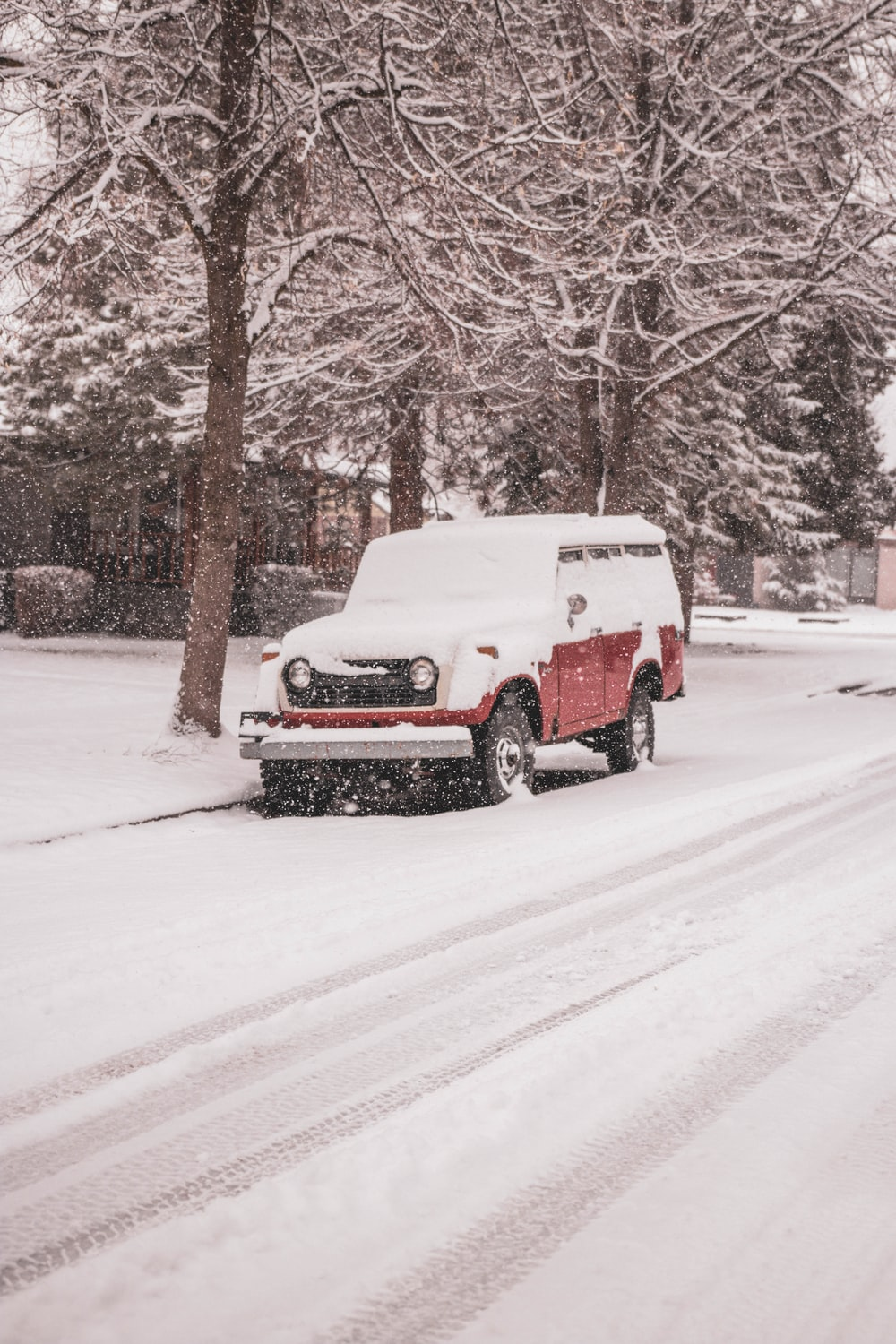 snow covered red jeep