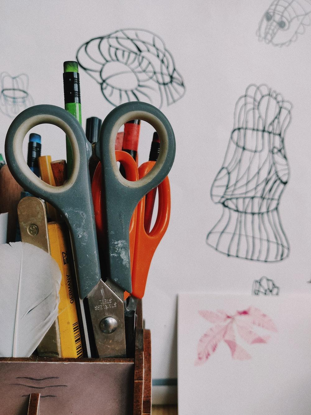 pen and scissors in vase