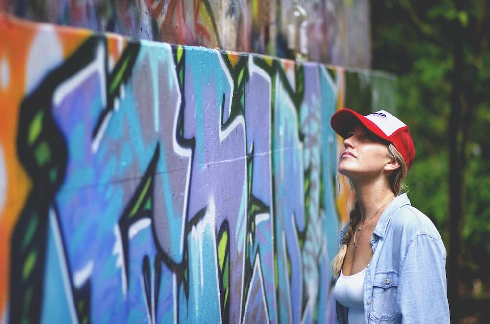 woman looking up on graffiti wall