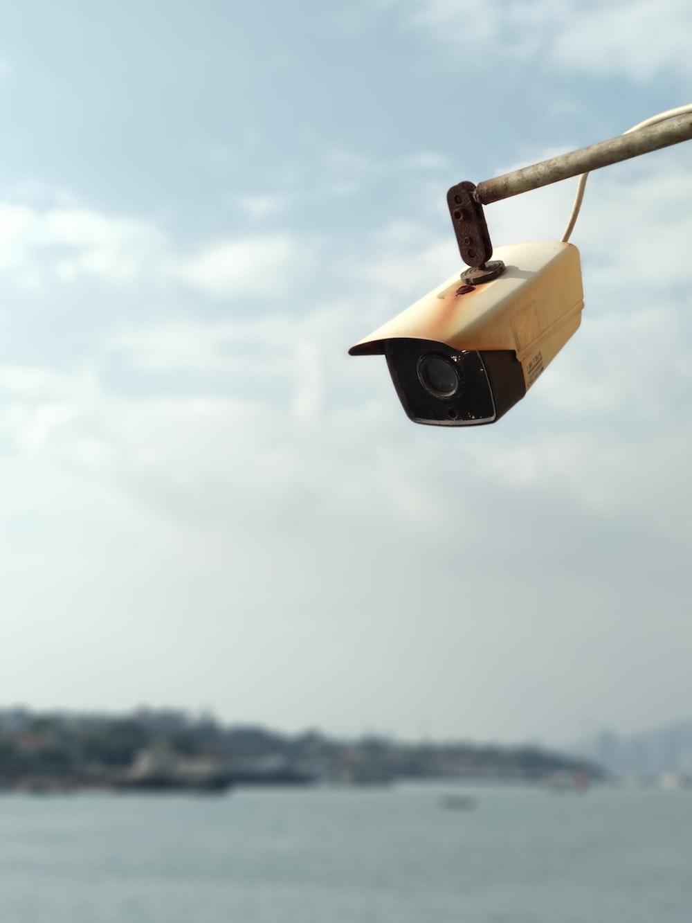 white surveillance camera looking down