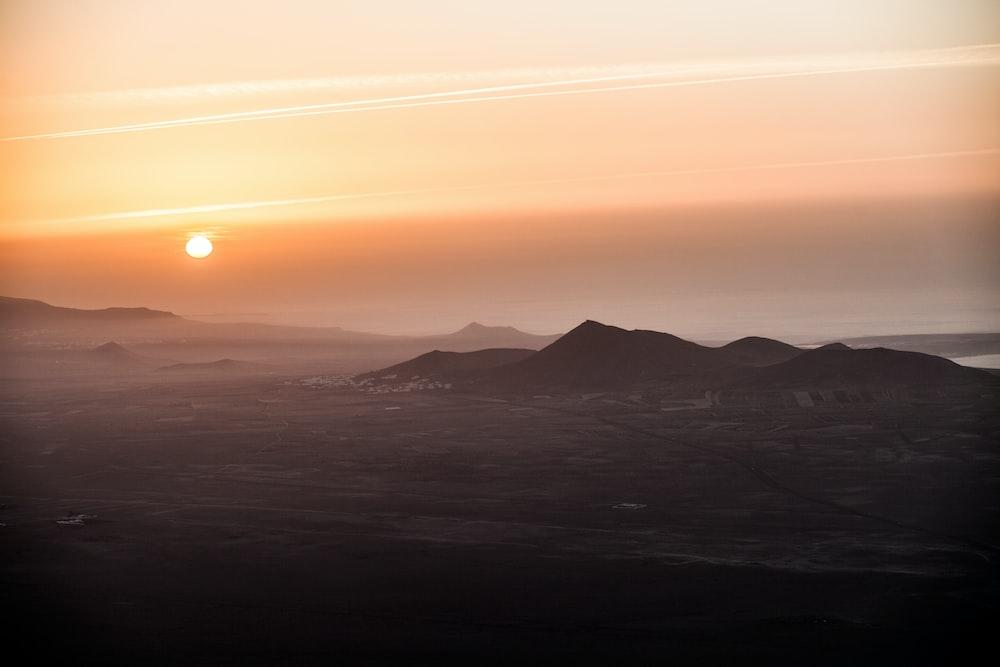 mountains under sunrise