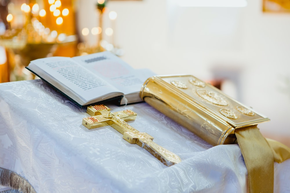 crucifix and Holy Bible on lectern
