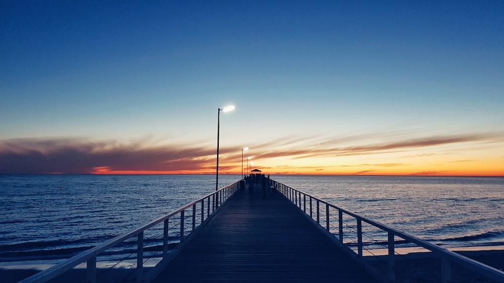 wooden dock during golden hour