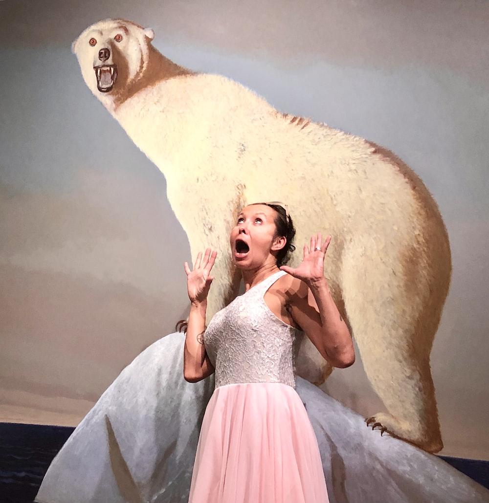 woman standing near polar bear painting