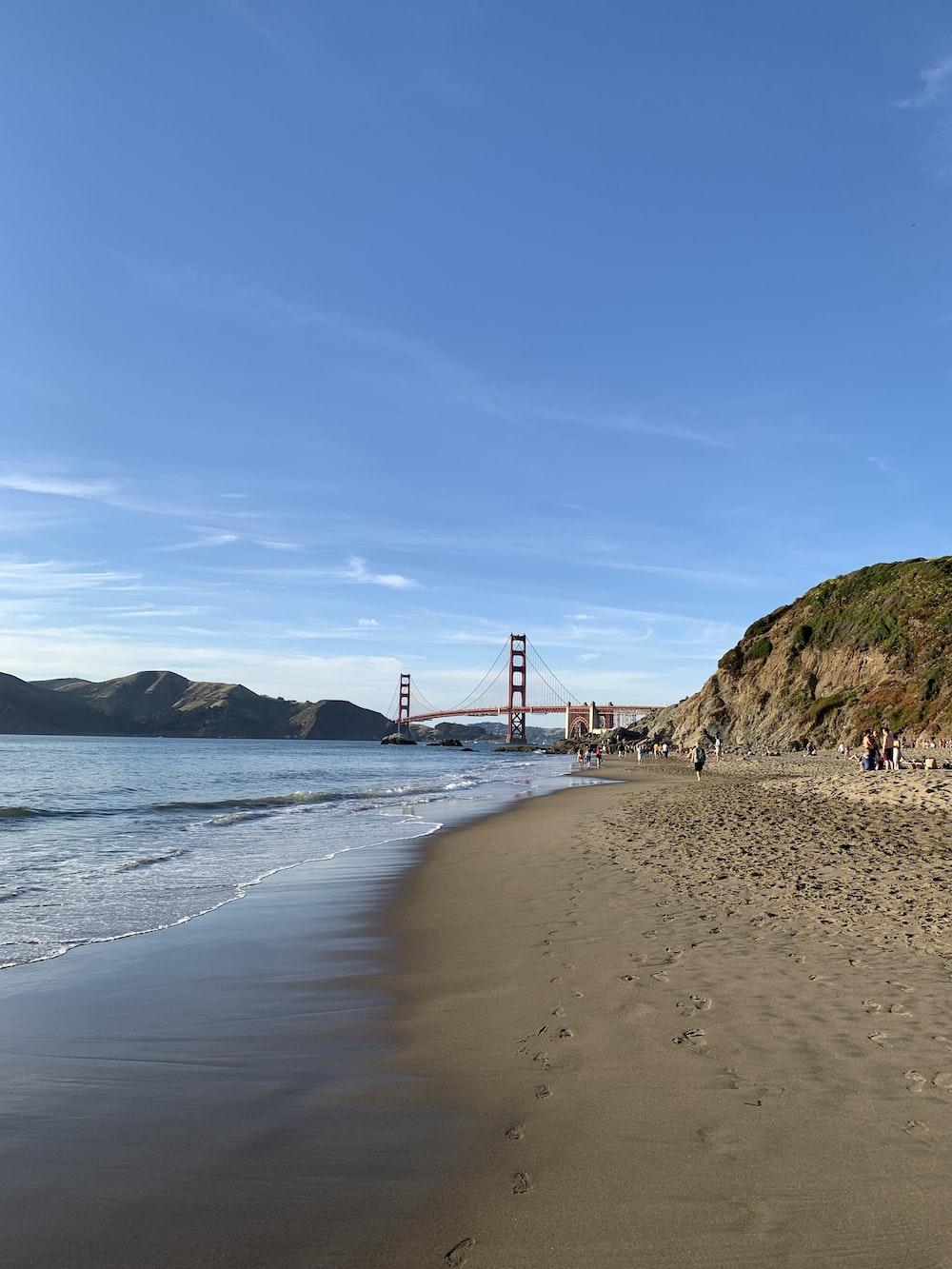Golden Gate Bridge under blue and white skies