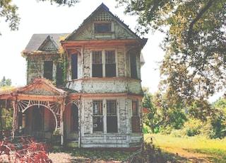 white wooden 2-storey house