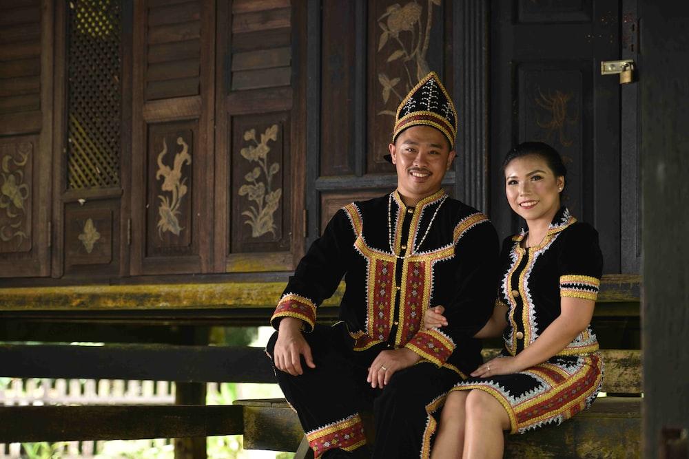 smiling man sitting beside smiling woman