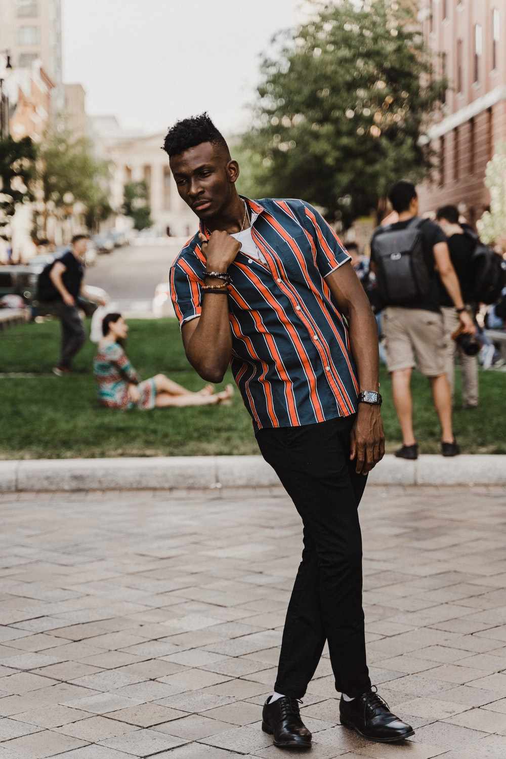 man wearing blue and red striped shirt