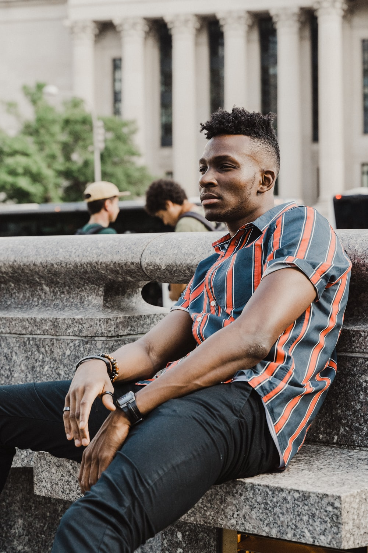 man sitting on concrete