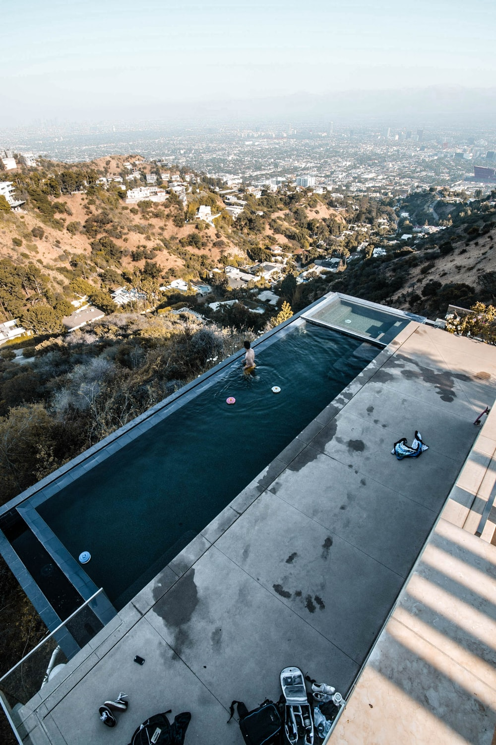 person in infinity pool during daytime