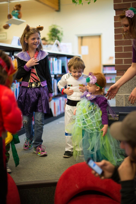 children in different costume standing inside room
