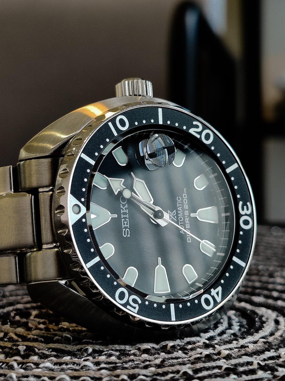 round silver-colored Seiko analog watch