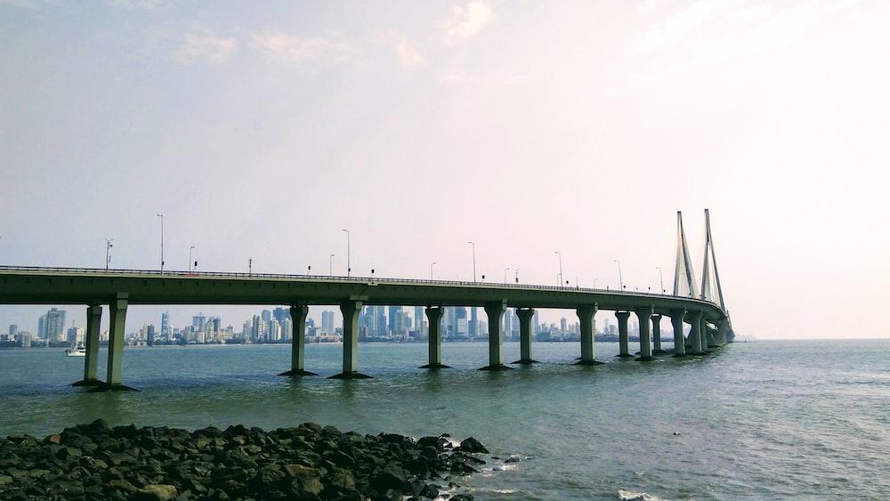 concrete bridge above body of water