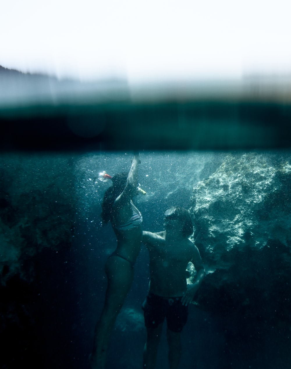 woman and man snorkeling under water