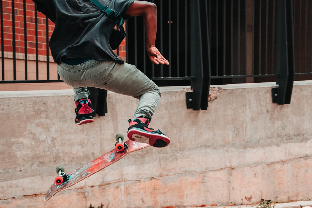 person skateboarding near fence