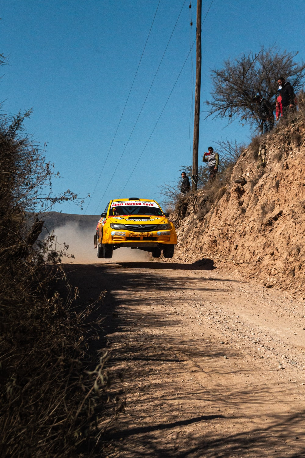 yellow rally car on road