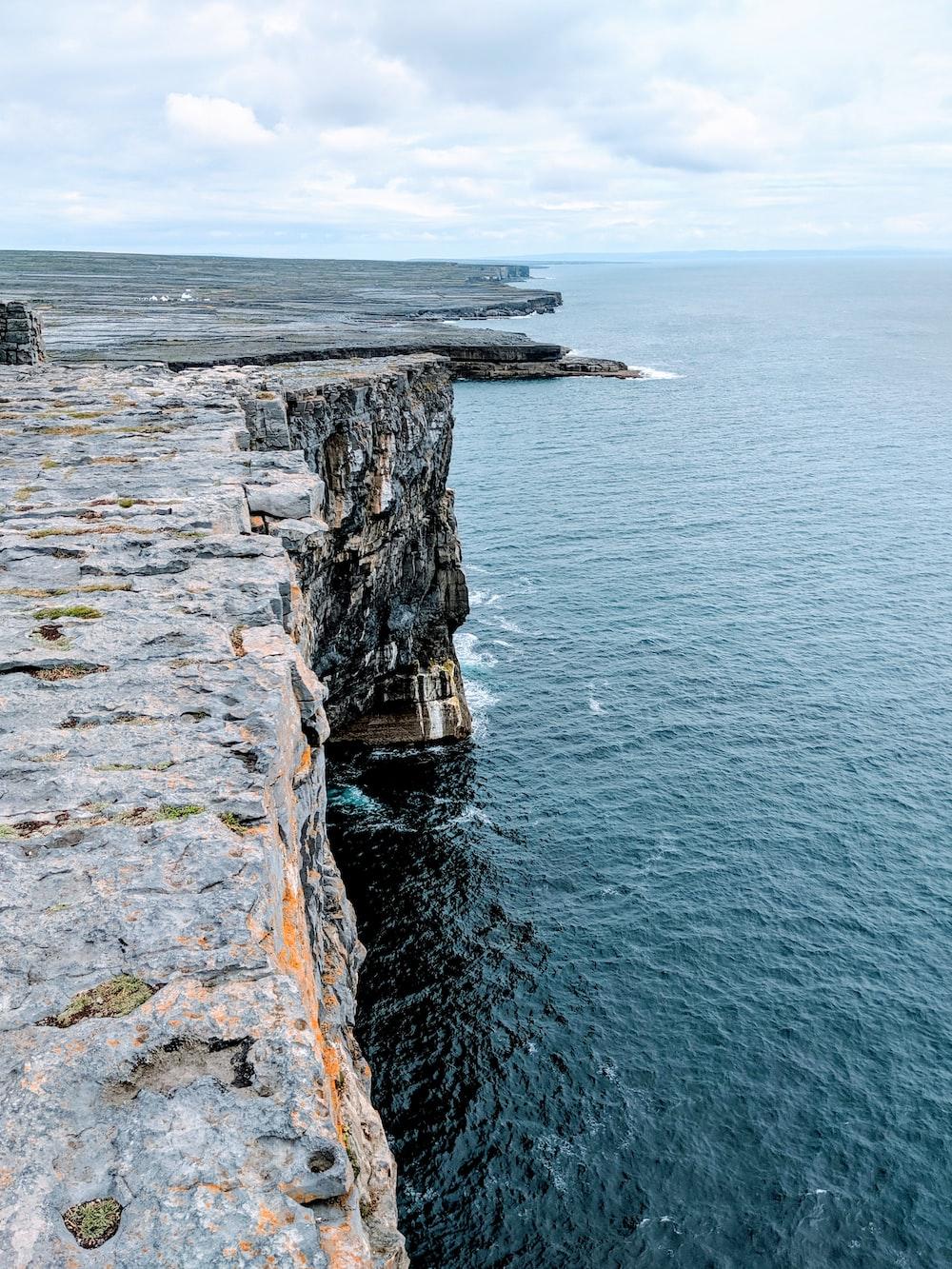 rocky cliff facing ocean