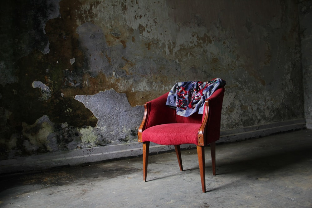 brown and red padded armchair