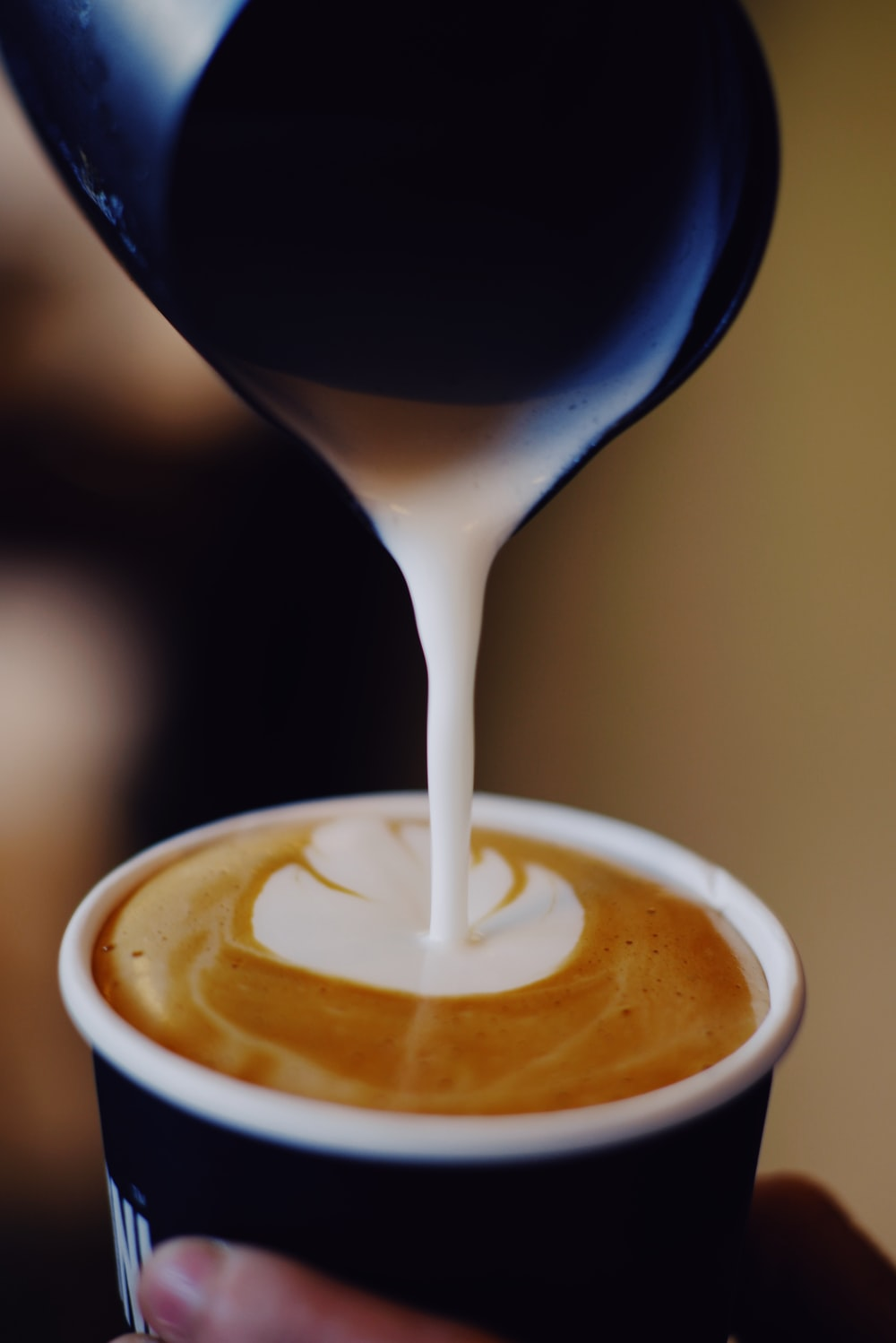 filling cup with coffee