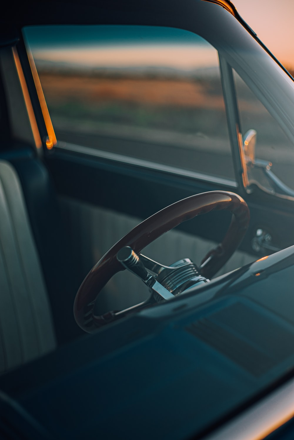 architectural photography of brown car steering wheel