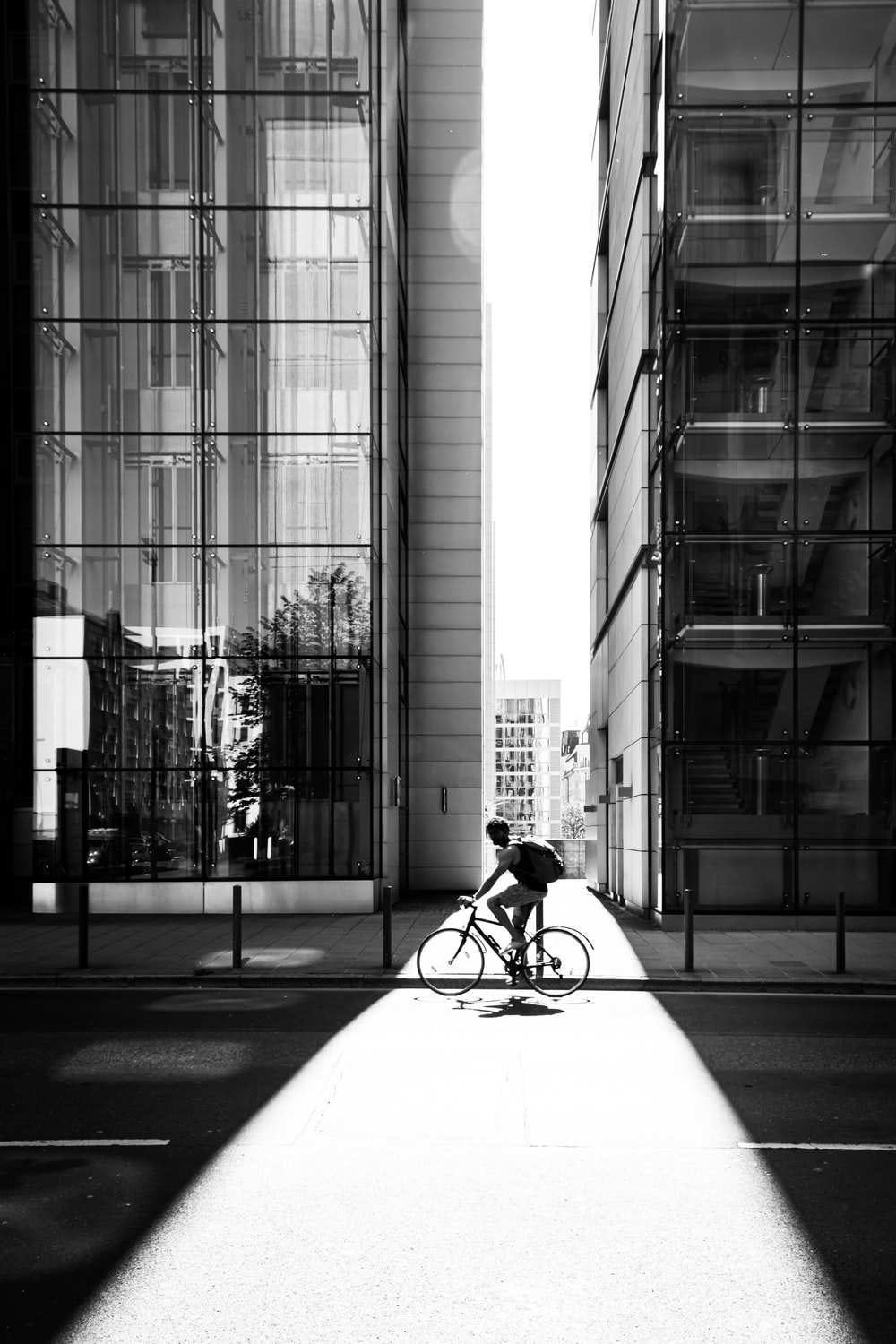 cyclist beside building