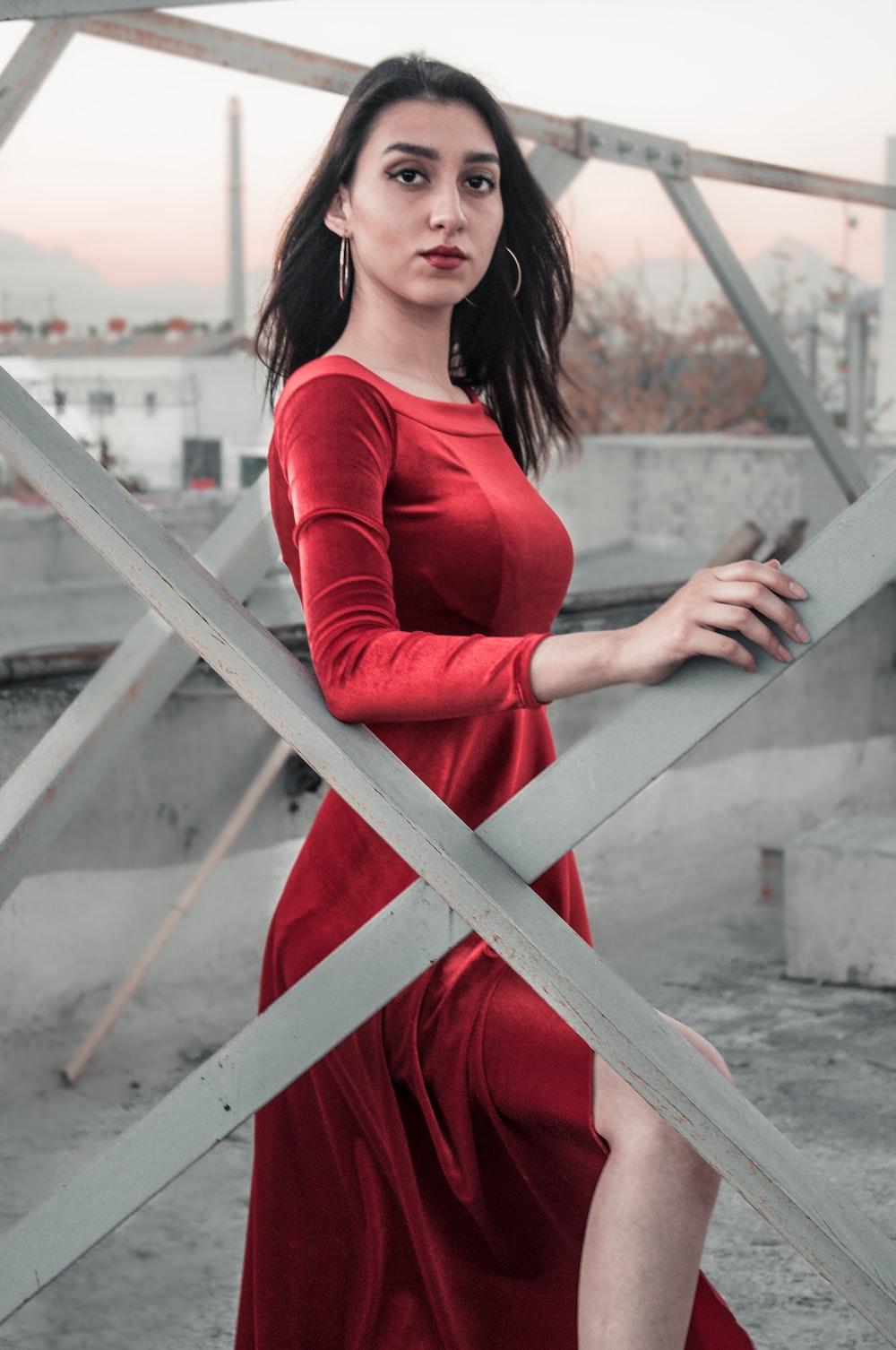 woman standing near metal fence