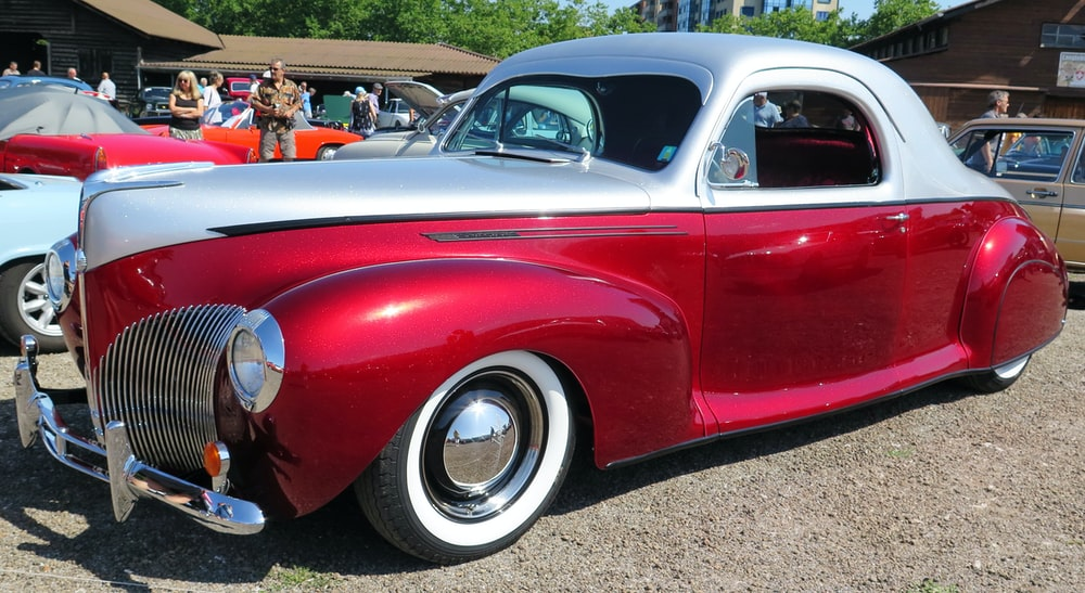 red and white classic car