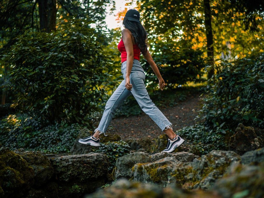 woman walking on stones