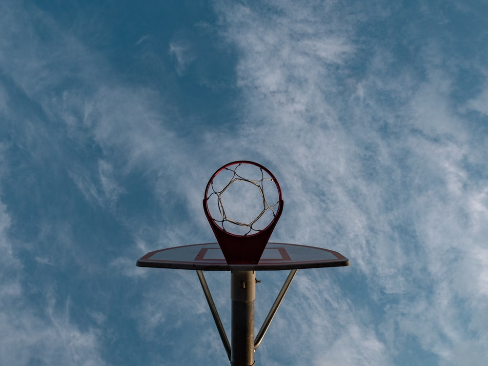 basketball hoop under cloudy sky