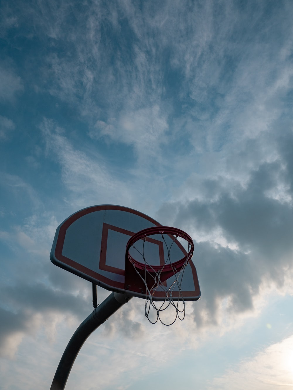 white and red basketball hoop during day