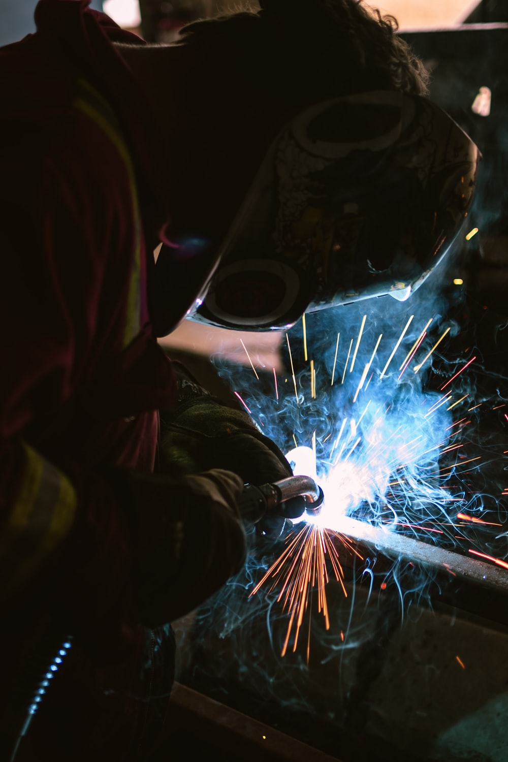 person wearing welding mask photo