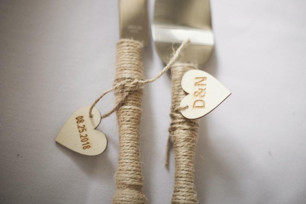 two brown rope handled cutleries