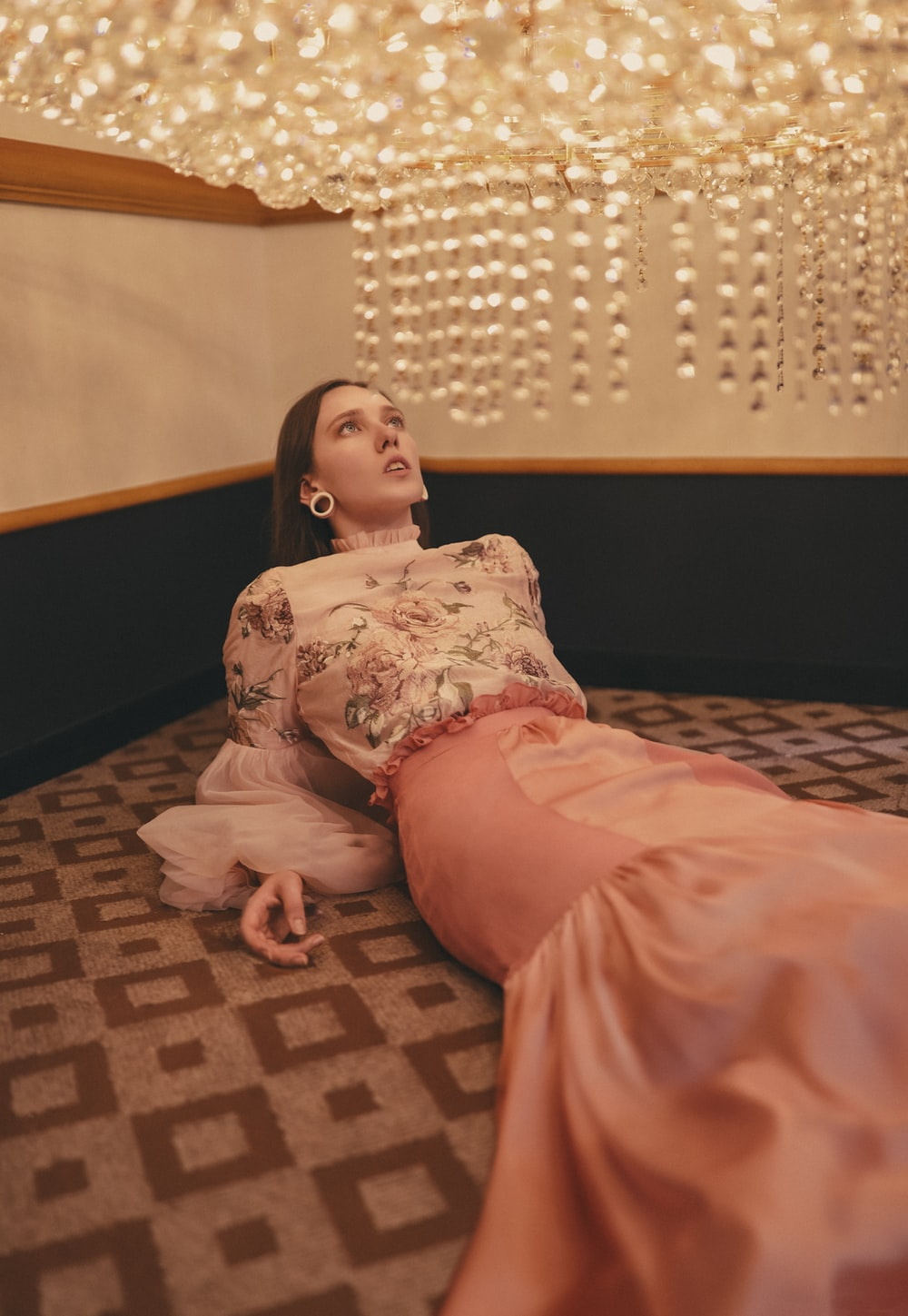 woman lies in area rug