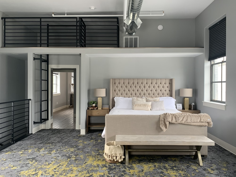 white and brown bed near window in a room