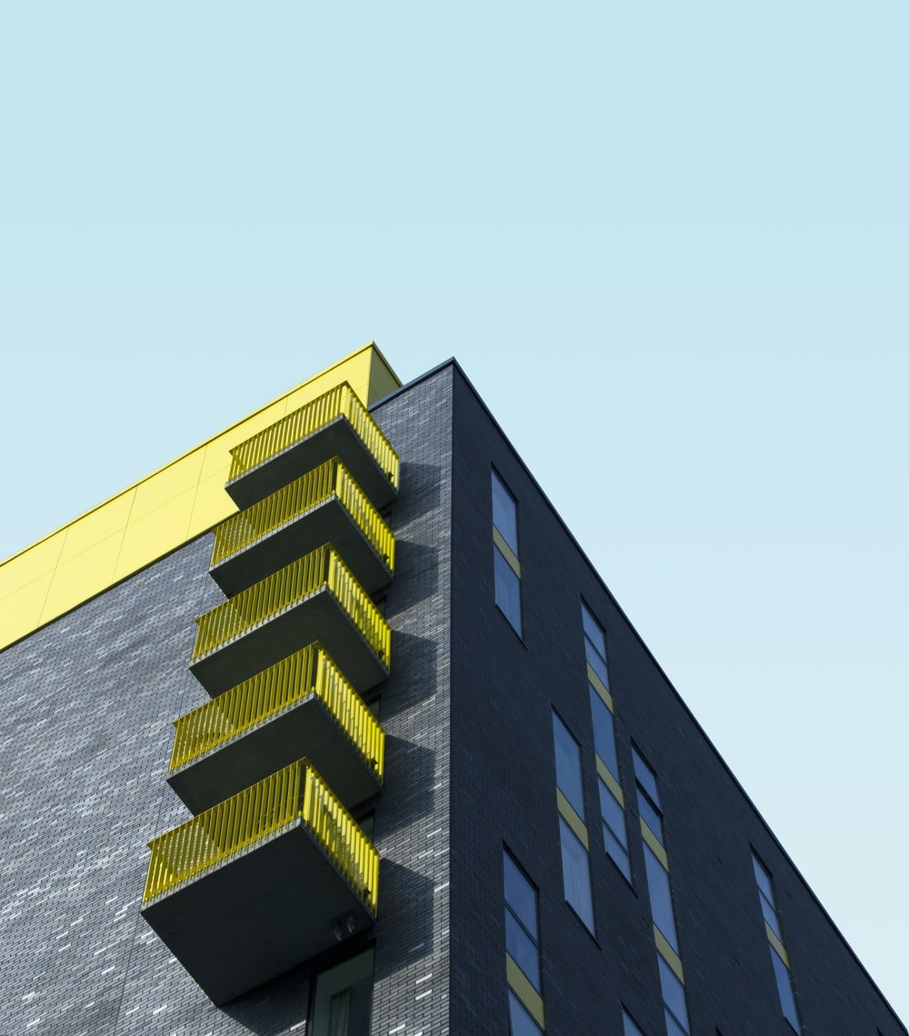 yellow and black building under blue sky during daytime