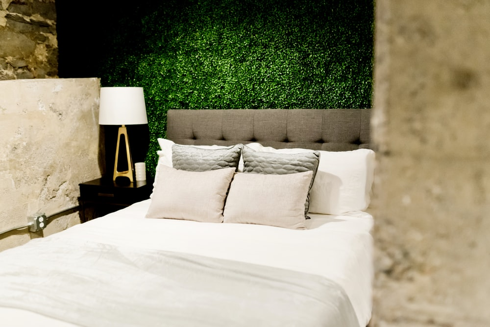 empty bed with throw pillows