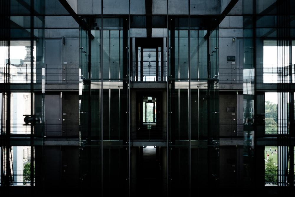 gray metal framed building ]