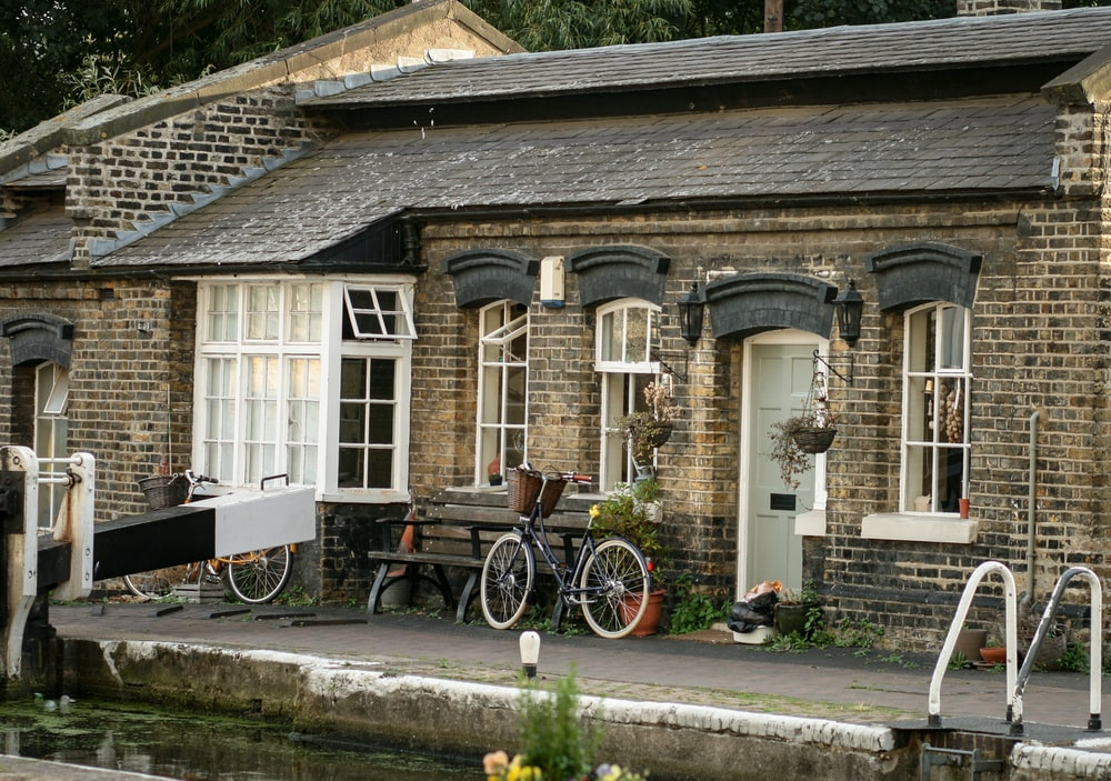 bicycle parked beside house