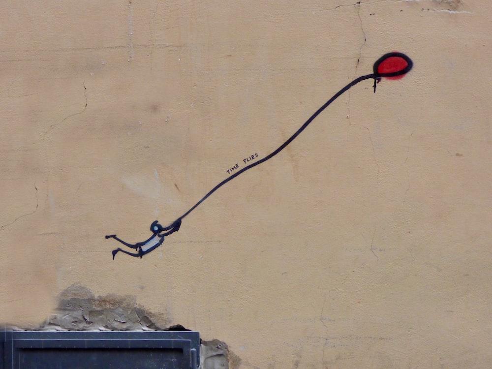 man holding balloon painting